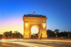 Bucharest, The Triumphal Arch at dusk. Bucharest, Tthe Triumphal Arch or Arcul de Triumf at dusk Royalty Free Stock Photos