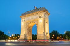 Bucharest, The Triumphal Arch at dusk. Bucharest, Tthe Triumphal Arch or Arcul de Triumf at dusk Royalty Free Stock Images