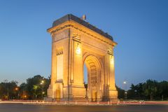 Bucharest, The Triumphal Arch at dusk. Bucharest, Tthe Triumphal Arch or Arcul de Triumf at dusk Royalty Free Stock Photography