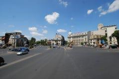 Bucharest University of Economic Studies, car, road, town, sky Stock Images