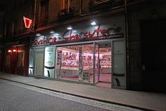 Buchers shoppar vid natten, Frankrike Fotografering för Bildbyråer