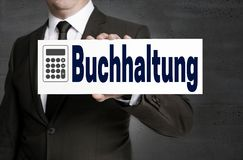 Buchhaltung in german Accounting signboard is held by business Stock Photo