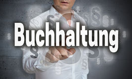 Buchhaltung in german Accounting touchscreen is operated by ma Stock Photo