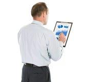 buchhaltung Geschäftsmann mit dem Finanzplan von Einkommen von t lizenzfreie stockbilder