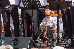 Buchlovice, Czech Republic, July 29, 2017: Little boy plays trumpet at folk festivities. Gifted child. Traditional farmers harvest Royalty Free Stock Photos