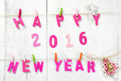 Buchstaben des guten Rutsch ins Neue Jahr 2016 auf hölzerner Beschaffenheit Stockfotos