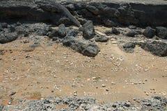 Buchstaben im Sand Lizenzfreies Stockfoto