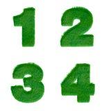 Buchstaben 1,2,3,4 machten vom grünen Gras, das auf Weiß lokalisiert wurde Lizenzfreie Stockbilder