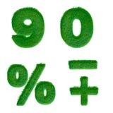 Buchstaben 9,0 machten vom grünen Gras, das auf Weiß lokalisiert wurde Lizenzfreie Stockbilder