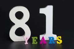 Buchstaben und Zahlen-achtzig einer auf einem schwarzen Hintergrund Lizenzfreie Stockfotos