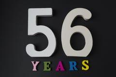 Buchstaben und Zahlen-fünfzig sechs auf einem schwarzen Hintergrund Lizenzfreies Stockfoto