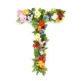Buchstaben von Blättern und von Blumen Stockfoto