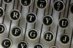 Buchstaben von oben genanntem auf einer alten Schreibmaschine Lizenzfreies Stockfoto