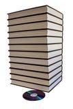 Buchstapel und eine DVD Platte Stockfotografie