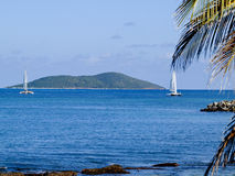 Buck Island and yachts. Scenic view of Buck Island Reef National Monument with yachts in ocean viewed from Saint Croix, United States Virgin Islands Stock Photo