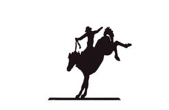 Buckaroos - Cowboy auf sträubendem wildem Pferd Stockfotografie