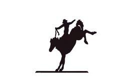 Buckaroos - cowboy on bucking bronco. Wild horse Stock Photography