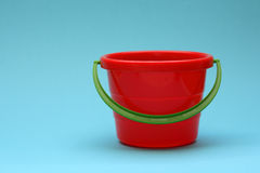 Bucket. Red bucket and a blue background Stock Images