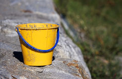 Bucket. Toy bucket of yellow color Royalty Free Stock Image