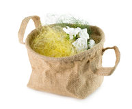Bucket with artificial flowers isolated on the white background Stock Photo