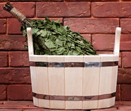 Bucket for a bath on a brick surface. Royalty Free Stock Images