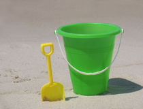 Bucket on the beach. Plastic bucket and shovel on the beach stock image
