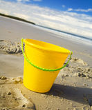 Bucket at the beach Stock Images