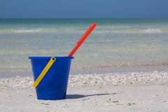 Bucket at beach. Blue bucket and red spade at the beach in Marco Island, Florida Stock Images