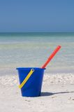 Bucket at beach. Blue bucket and red spade at the beach in Marco Island, Florida Royalty Free Stock Photo