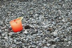 Bucket on the beach Stock Photo