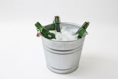 Bucket of beer on Ice. Green beer bottles inside a ice bucket Stock Photos