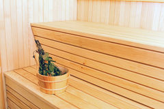 Bucket with birch broom in sauna Royalty Free Stock Image