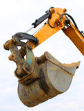Bucket of a bulldozer during the roadworks Stock Images