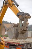 Bucket of a bulldozer and a truck in the background Royalty Free Stock Photos