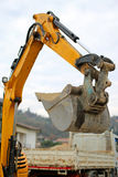 Bucket of a BULLDOZER and a truck in the background during the r Stock Photography