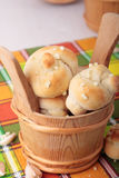 Bucket of buns with salt and garlic Royalty Free Stock Photo