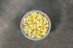 Bucket of buttered Popcorn viewed from above stock photo