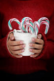 Bucket with candy canes Royalty Free Stock Photos