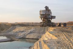 Bucket chain excavator in a sand quarry. Giant stacker. Bulk material handling.  royalty free stock photos