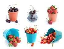 The bucket of cherries and strawberries set Stock Images