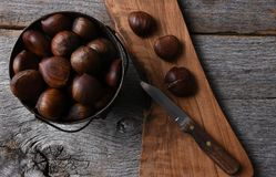 Bucket of Chestnuts and knife Stock Photos