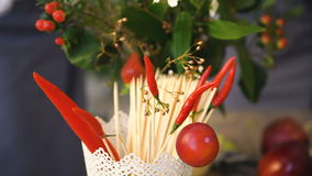 Bucket with chilli and wooden sticks for food with background of chef florists work. At flowers fruit shop t in kitchen studio closeup stock video