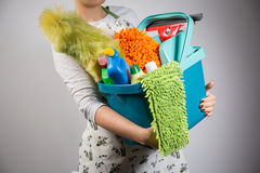 Bucket with cleaners. Close-up of woman holding bucket full of cleaners royalty free stock photography