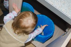 In a bucket of cleaning out the garbage child Royalty Free Stock Images