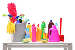 Bucket and cleaning supplies on a table Royalty Free Stock Photography