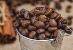 Bucket of coffee beans Stock Images