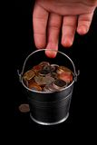 Bucket of coins. And hand, money, cents Stock Image