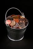 Bucket of coins Stock Images