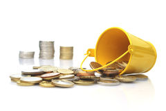 Bucket and coins. Stock Photo
