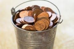 Bucket with coins Stock Photos